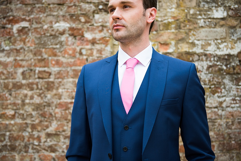 11 da stylish groom in blue suit with pink tie norfolk