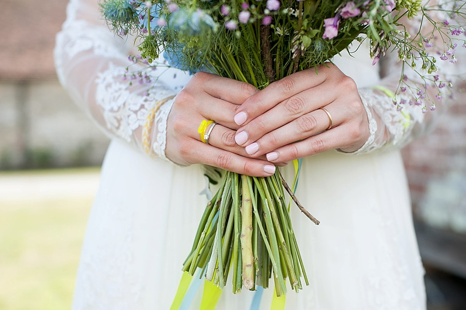 ... Close Up Of Brideu0027s Hands Wearing Engagement Ring On Right Hand And Wedding  Ring On Left