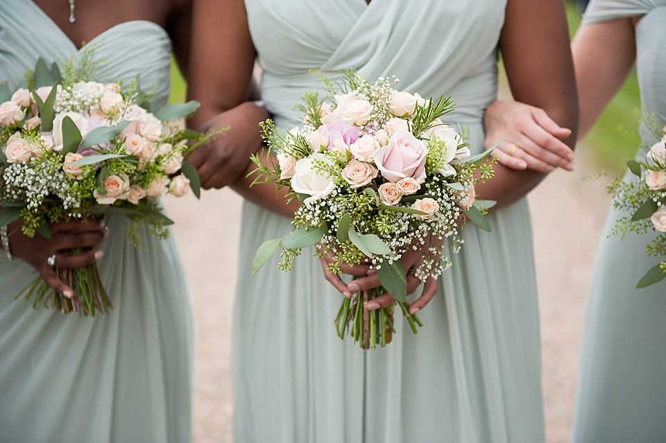 Light Purple Bridesmaid Dresses Holding Flower Boquet